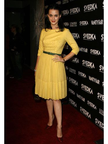 The songstress shows off her range of color in a bold yellow dress with equally  eye-catching accessories.