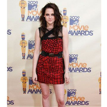 The <i>Twilight</i> star added Converse sneakers to a Yigal Azrouël red-and-black minidress for her big night. She took home awards for Best Movie and Best Female 