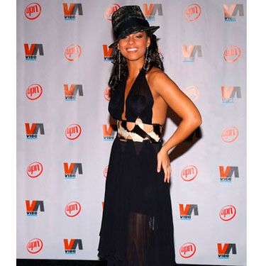 Alicia accessorizes her black halter dress with a black fedora to create one of her signature looks at the VIBE awards.