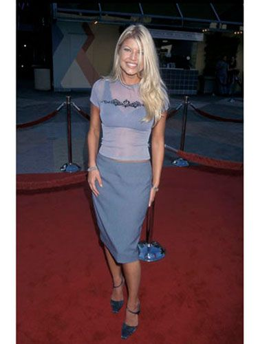 We can't decide which is harder to believe: the fact that she was wearing a calf-length skirt on the red carpet or that the person wearing it was known as Stacy Ann Ferguson in the girl band Wild Orchid.