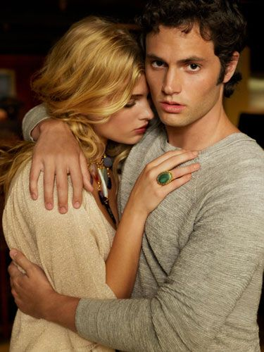 """<i>""""A bold accent can fade away, leaving you focused on the beautiful woman wearing it."""" —Penn Badgley</i><br /><br /> On her: sweater, XOXO, $49; necklace, Tova, $115; ring, Azaara, $262. On him: sweater, 3.1 Phillip Lim, $325 <br /><br /> <b>Beauty tip:</b> If he's getting thisclose, you'll want to smell irresistible. Try a romantic floral, like <a href=""""http://www.esteelauder.com/product/spp.tmpl?CATEGORY_ID=CAT612&PRODUCT_ID=3566"""" target=""""_blank"""">Estée Lauder Sensuous</a>, $42."""