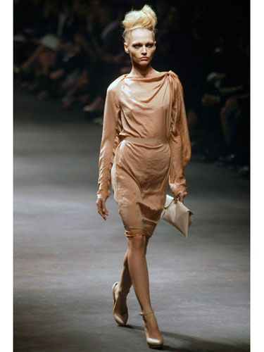 Lanvin designer Alber Elbaz is known for his exquisitely draped dresses, and his designs look especially chic in such a soft, understated color. Don't be afraid to match your shoes — wearing flesh-tone heels always makes legs look longer.