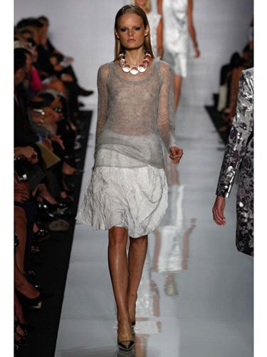 Who says you have to look frumpy once the temperature drops? With his airy, barely there knits, Michael Kors gives sweaters a sexy edge. Wearing sheer is even naughtier in such a classic style and paired with a ladylike skirt.