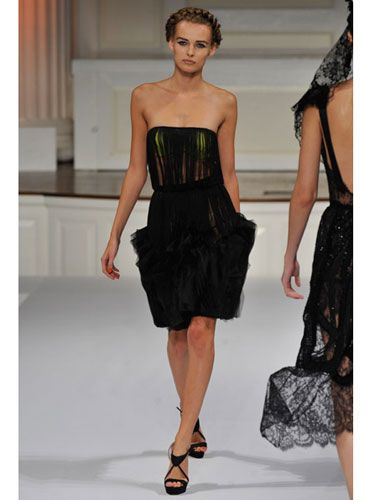 A sheer bodice adds sex appeal to Oscar de la Renta's demure cocktail dress. If going out in something see-through isn't daring enough for you, a neon-bright bra will certainly spice things up.