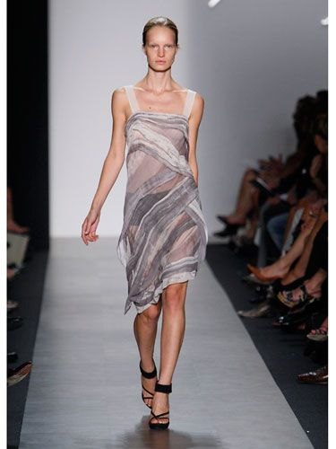 Well-placed strips of decorative fabric give Max Azria's transparent organza dress just enough coverage. Wear boy shorts for a cuter, sexier alternative to a half-slip.