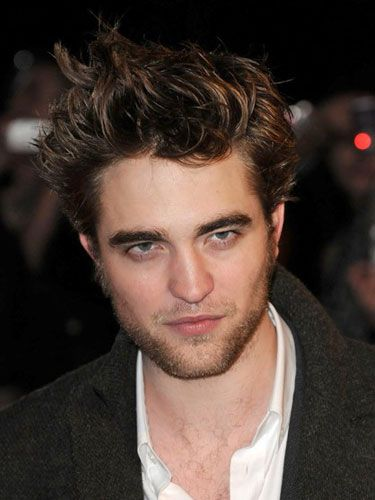 2. Robert reportedly got a six-pack for <i>New Moon,</i> thanks to makeup artists and strategic airbrushing. We'd like to inspect the evidence to find out for sure.