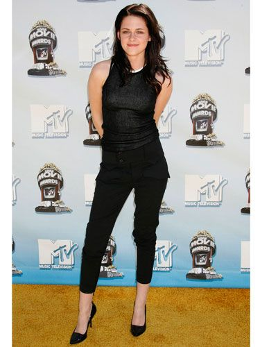 In black hot pants, a slinky tank, and killer heels, the brunette bombshell got into her style groove at the MTV Movie Awards.