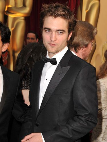 We're used to seeing Robert Pattinson either superpale (in <em>Twilight</em>) or supergreasy (in real life), so we weren't 100 percent sure he was capable of setting foot in daylight or rinsing his hair. What a champ: For the Oscars, he temporarily overcame his self-confessed disdain for personal hygiene and put on a handsome suit. We think he's never looked better.