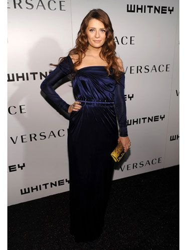 Who needs to star in a show called <i>The Beautiful Life</i> when you're clearly living it? Mischa looked elegant in a long-sleeved blue silk jersey gown and a yellow clutch.