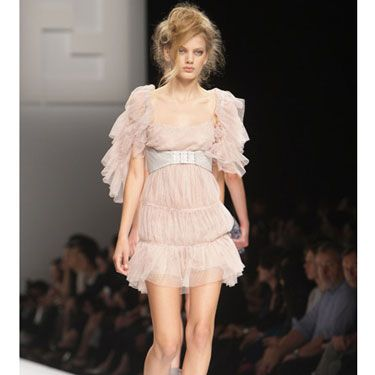 Tiered-ruffle sleeves and an empire-waist make this pink chiffon Fendi dress extra-dreamy. You can give something soft and sweet a sexy edge — like the designer does here — by wearing it with a pair of saucy, strappy heels.