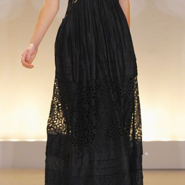 """""""The long and fluid skirt billows to echo the fantasy spirit of the collection.""""<i>—Collette Dinnigan</i><br /><br /><b>Tip:</b> If you need a long dress hemmed, make sure to try it on with the heels you are going to wear when you are at the tailor so the hem isn't sewn too short. Peeping shoes would detract from the overall effect of this long, flowing skirt."""
