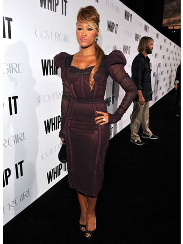 Talk about fierce! Eve showed off her svelte figure in a burgundy bustier dress by Dolce & Gabbana.
