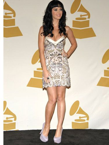 "Nothing says, ""Kiss me under the mistletoe"" like Katy's V-neck strapless mini and platform pumps."