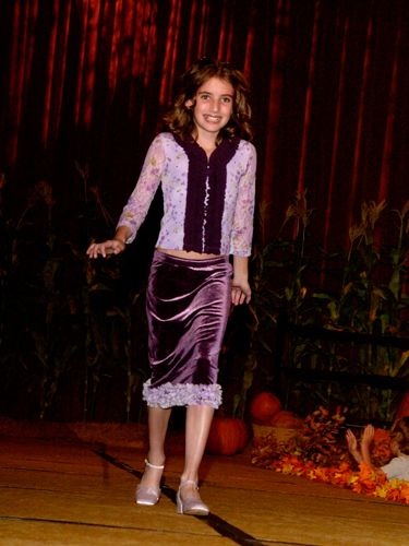Dressed head to toe in purple, the young actress looked adorable at a luncheon in Beverly Hills.