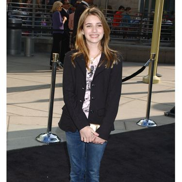 At a premiere in Los Angeles the actress dressed up flared jeans with a sophisticated blazer.
