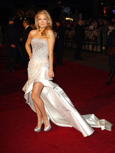 Kate is a magazine film critic in the musical film <em>Nine</em>, but as far as we're concerned, this elegant strapless Versace gown is cover girl material.