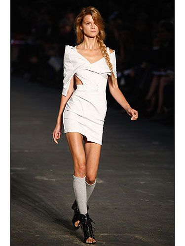 Alexander Wang included several body-conscious dresses in his sexy, sport-inspired collection for spring. Here he uses sweatshirt fabric to give this form-fitting frock a more casual vibe, and he scores extra points with the bold shoulder detail that draws attention upward and makes hips appear slimmer.