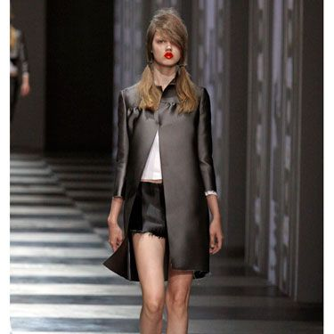 Prada's shiny silver coat offers a low-key way to go space-age. These short-shorts are a bit risqué for city streets, but paired with skinny black pants or light-wash jeans, a silver coat looks modern and chic.