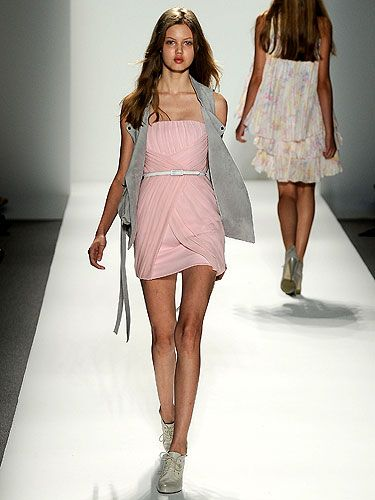 """""""The Cynthia Steffe girl wears her favorite feminine pieces and mixes them up with things she's borrowed from her boyfriend.  This look — a sexy minidress worn with a suede utility vest — is a perfect example of that kind of mixing and matching."""" —Shaun Kearney<br /><br /> <b>Tip:</b> Don't be afraid to mix feminine with masculine. It's an easy way to make the girlie pieces in your closet a bit more edgy and hot."""