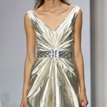 """The metallic stripes are gracefully seductive, and the texture enhances the feminine silhouette."" —Luisa Beccaria