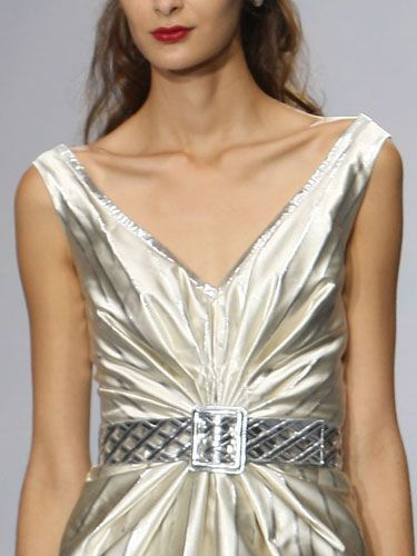 """""""I love the strong emphasis on the neckline."""" —Luisa Beccaria   <br /><br /><b>Tip:</b> Typically, a necklace or earrings would complement a neckline like this, but when the fabric of the dress is so shiny, jewelry would be overkill."""