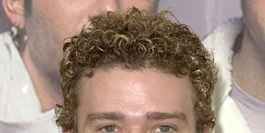 """We were totally crushing on JT's curly cues back in his """"No Strings Attached"""" days. Too bad the 'N Sync heartthrob couldn't just say bye, bye, bye to acting. But hell, he's so cute, we forgive him for <em>Alpha Dog</em>."""
