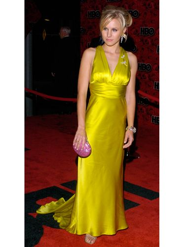 The <i>Veronica Mars</i> actress went glam in a long yellow gown with a dramatic train.