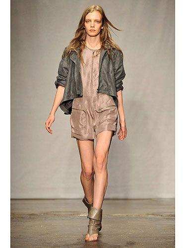 Richard Chai balances out this leggy look by adding a sporty cropped anorak. The silky fabric gives this normally boyish-looking jacket sex appeal, while the muted color palette makes the casual styles more refined.