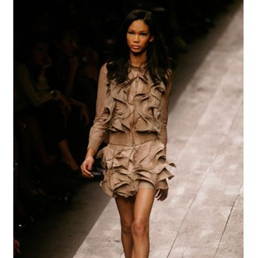 At Valentino the traditionally tough material was skillfully transformed into sweet ruffles. The jacket and skirt looked great together on the runway, but on the street this much leather might be too much, so pair either piece with casual separates like jeans or a simple sweater.