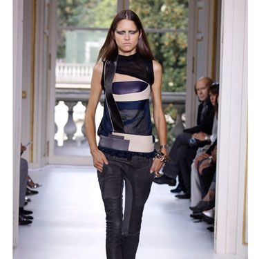 Not a single look went down the runway at Balenciaga without a least a touch of leather. This sexy, urban collection showcased many brilliant combinations of skin and fabric like this top. Most impressive to us, though, were these leather pants that fit like spandex.