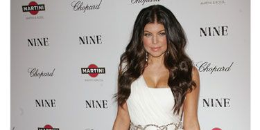 To celebrate her acting debut, Fergie went old Hollywood glam in her Marchesa goddess gown with a jewel-encrusted belt and matching clutch. Someone get this girl a follow-up gig!