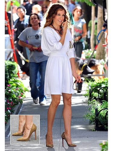The undisputed idol of every shoe-loving girl, Carrie Bradshaw struts through New York City in glittery gold Christian Louboutins.