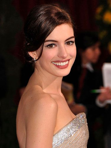 Anne Hathaway has killer lashes. Julie Harris, celebrity makeup artist in New York City, suggests you get her look by first letting your face lotion dry fully before working on your eyes. This way, you prevent smudging. And  use a light powder over your under-eye concealer.