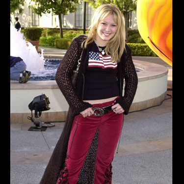 The Houston native was just like any other mall rat — except for the fact that her alter ego, Lizzie McGuire, was the most popular Disney character of the time. And since she was only 14, we'll excuse the embellished red velour hip-huggers and knit sweater cape.