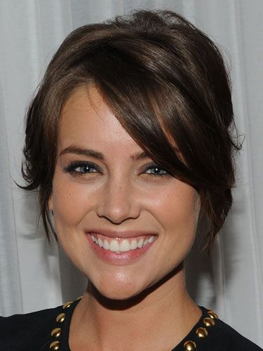 "<p><strong>""I think it looks cool and mysterious when a girl has one eye almost covered by her bangs. It's definitely sexy."" —Michael, 22</strong></p> <p>To get your bangs to fall just like Jessica Stroup's, use a dab of styling cream and blow dry them with a round brush to add some bend to the ends.</p>"