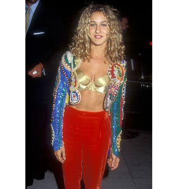 "With her velvet gypsy pants, exposed gold bra, and multicolored blazer, the young star discovered the ""Genie in a Bottle"" style way before Christina Aguilera."