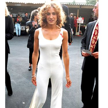Whether the bell-bottomed jumpsuit is a do or don't (we're leaning toward the latter), the actress showed off her hottest accessories — sexy hips, toned arms, perfect curls — and still pulled it off.