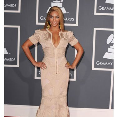 Gold was definitely the right color for Beyoncé to wear on the red carpet. Not only did the diva kick ass onstage, she become the first woman to ever win six freaking awards in one night.