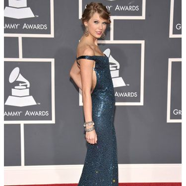 """Fearless"" won album of the year, and in an ultra glam off-the-shoulder blue Kaufman Franco gown, this country songstress proved that she belongs with music royalty. Kind of brings a new meaning to Team Taylor, huh?"