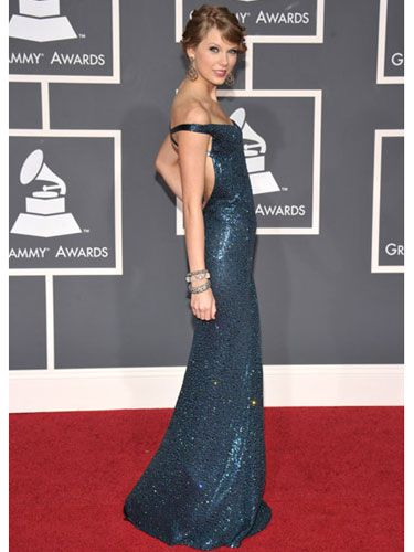 """""""Fearless"""" won album of the year, and in an ultra glam off-the-shoulder blue Kaufman Franco gown, this country songstress proved that she belongs with music royalty. Kind of brings a new meaning to Team Taylor, huh?"""