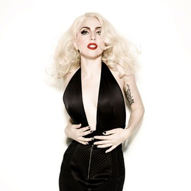 Lady Gaga does Old Hollywood in this very deep V-neck Jean Paul Gaultier gown and platinum blond retro curls.