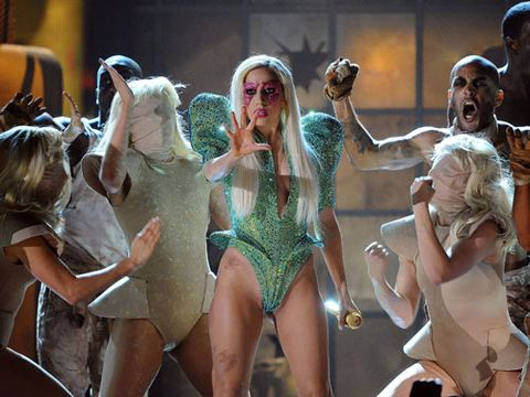 """In a show-stopping opening number, the two-time Grammy-award winner sang """"Poker Face"""" in a glittering green heart thong leotard and matching pumps. Good luck topping that, Grammys 2011."""