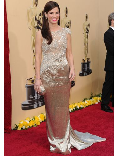 Perhaps <i>The Blind Side</i> leading lady was trying to send the Academy a subtle message with her gold-beaded gown that looked a lot like an Oscar statue. Must have worked; not only did she look gorgeous (and five years younger), but she also won Best Actress.