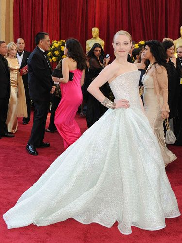Thanks to one hell of a train, the tiny actress made quite an impression on the red carpet in an icy silver strapless gown by Armani.