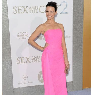 Who other than sugar-sweet Charlotte could make pink look this pretty? KD positively glowed in this Jean Desses for Decades chiffon gown.