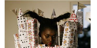 """This fashion house recently tweeted """"Less is more."""" Perhaps something was lost in translation and by """"less"""" they meant """"a corset slash headpiece castle made out of playing cards."""""""