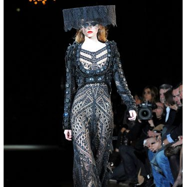 Sequins, feathers, and sheer fabrics dominated this show, but most interesting were the lampshade-looking headpieces that some of the models donned. Could this be the new fedora? We highly doubt it, but props to anyone ballsy enough to rock one this spring.
