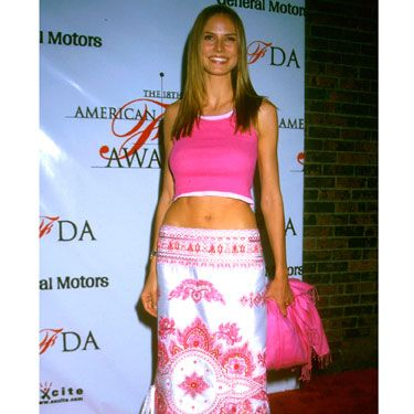 """We don't blame her for wanting to flaunt those sexy abs, but her tiny top and sari skirt are a little too """"beachy"""" for the red carpet."""