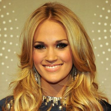 Long layers will enhance your natural texture and give your hair a fuller look. Ask your stylist to snip you a few, especially around your face, like Carrie Underwood has here.