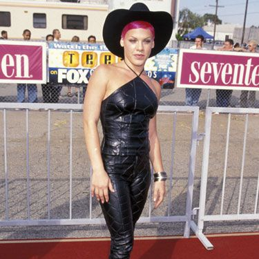 We can't tell if Pink is trying to round up some fans or audition for a side gig as a Dominatrix in this all-leather getup and cowboy hat.